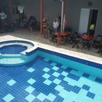 Chácara - Casa condomínio fechado com piscina aquecida