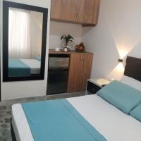 Habitación independiente con baño privado, nevera minibar, tv androide, cama doble, cómoda y confortable, Excelente ubicación, #5