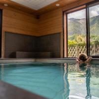 Gîte Balnéo Au Coeur des Alpes, hôtel à Taninges