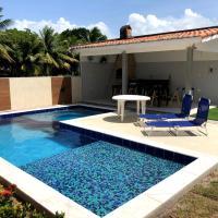 Casa completa com piscina e área de laser completa na praia BELA - PB, hotel in Pitimbu
