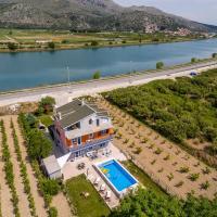 Holiday house with a swimming pool Opuzen, Neretva Delta - Usce Neretve - 8818, hotel in Opuzen