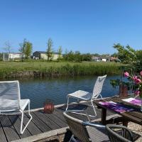 Ferienpark Vislust Ferienhaus Balu mit eigenem Steiger zum angeln Ijsselmeer Niederlande