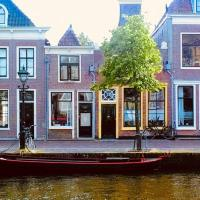 Typical Dutch charming canal house in Alkmaar