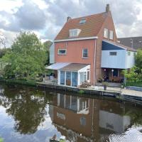 Characteristic detached house next to water