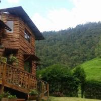 Cabaña en reserva forestal a 10 minutos de Manizales, hotel en El Charquito