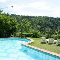 Panoramic apartment with communal pool and private garden