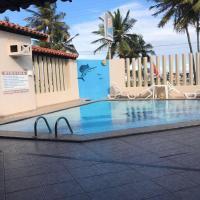 OYO Pousada Florais Do Atlântico, hotel in Praia do Saco