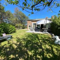 Attractive holiday home, sunny garden, 150 meters from the beach