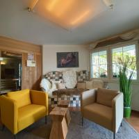 Modernes Alpenapartment mit Sauna / Whirpool / Pool / Wintergarten, hotel in Adnet