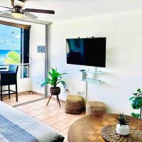 Wake up to ocean waves in beachfront apartment, hotel near Luis Munoz Marin International Airport - SJU, San Juan