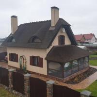 Дом под камышовой крышей, отель в городе Kamenka