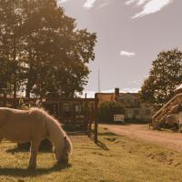 Farmlodge, hotell i Brastad