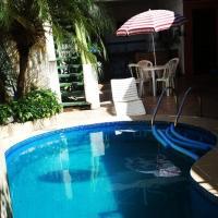 Pousada Charme Charmant, hotel in Praia Grande