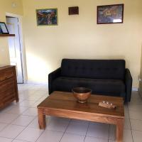 Apartment with one bedroom in FortdeFrance with wonderful sea view enclosed garden and WiFi 2 km from the beach