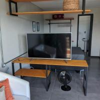 Flat, ótima localização., hotel in Gravataí