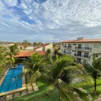 Apartamento com vista para o mar, piscina , deck , playground e estacionamento ., hotel in São Gonçalo do Amarante