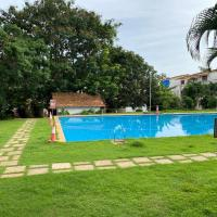 PS holiday homes B5-SF, hotel in Candolim