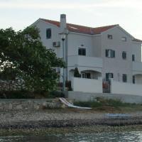 Apartments Azur - 10 m from sea, hotel in Ilovik