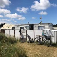Knusse caravan camping Duinoord 300m van strand