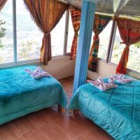Hostal refugio ojos del volcán, hotel em Lligua