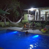 Complexo com 2 casas, camping piscina na Macaneta, hotel in Maputo