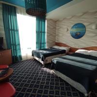 Three Dolphins Hotel, hotel in Aktau