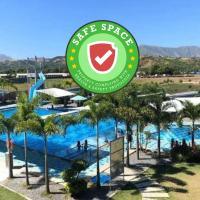 RedDoorz Plus @ JJB Aquafarm Resort Castillejos, hotel in Castillejos
