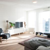 Modern apartment, balcony overlooking exclusive seaworthy yachts