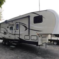Air Conditioned 2018 RV trailer in secure yard