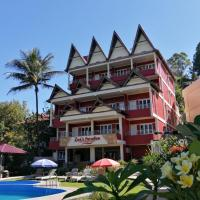 Zoé's Paradise Waterfront Hotel, hotel in Tuktuk Siadong