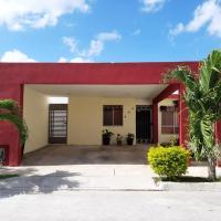Cómoda casa con estacionamiento y WiFi a 15min del aeropuerto, hotel in Mérida