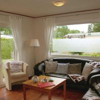 Tidy chalet with a microwave, near the Wadden Sea