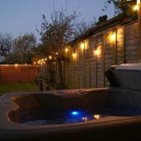 Well equipped large home with hot tub & log burner