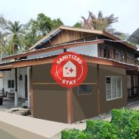 OYO 90176 D'cruz Sunrise Villa, отель в Кампунг-Паданг-Масирате