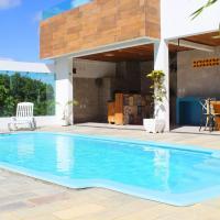 Casa com piscina privativa e poucos passos do mar em Cotovelo por Carpediem