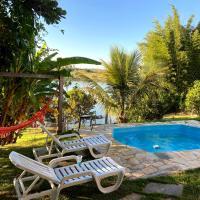 Casa com piscina fundo pra represa e AR Condicionado CasinhaBrancaDeVaranda