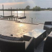 Overnachten aan de Maas in een fijne chalet