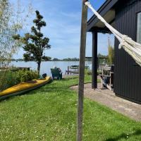 The Outpost lakehouse - heerlijk natuurhuis aan Reeuwijkse Plassen bij Gouda -, hotel in Reeuwijk
