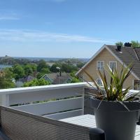 Leilighet med flott utsikt og sentral beliggenhet med plass til 4, hotell i Larvik