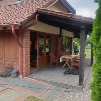Agroturystyka Nad Stawem Dom w Borach Tucholskich – hotel w mieście Wycinki