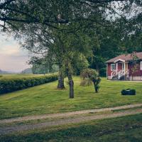 Holma Stångenäs Golf Bed & Breakfast, hotell i Brastad