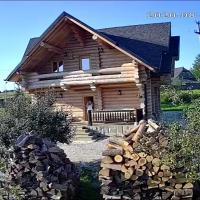 Cabana lemn rotund cu ciubar de închiriat Bucovina Chalet