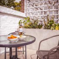 Olive Tree - fabulous central location with patio garden & parking space