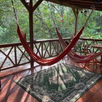 Caoni Riverside Suites - Birders Paradise by the river, Ecuadorian Chocó, hotel em Puerto Quito