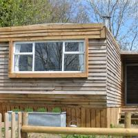 Cosy and naturistic Lodge at Goldhill Glamping UK