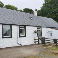 New cosy cottage with sea views