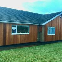 Shore Lodge. 4 bed bungalow only mtrs from the beach. Sleeps 8