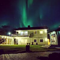 Beachhouse with jacuzzi and grillhouse, hotel in Sommarøy