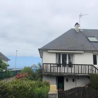 Grande maison vue sur mer