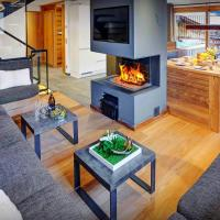 Beautiful ski chalet sleeps 11 with stunning views cosy open fire & outdoor hot tub close to pistes & village